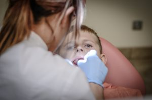 Concerned child getting dental care